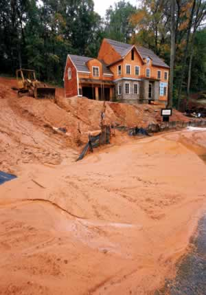 Sediment, combined with nonpoint-source pollutanta, is washing down from many Atlanta-area homesites and choking metro waterways. Photo by Richard T. Bryant. Email richard_t_bryant@mindspring.com.