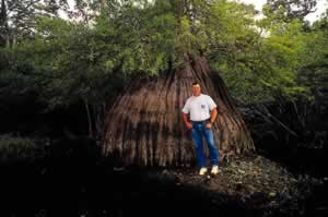 Jerry McCollum in front of an ancient cypress in Ebenezer Creek near the Georgia Coast. The protection of Georgia's special natural areas has been a major goal of his. Photo by Richard T. Bryant. Email richard_t_bryant@mindspring.com.