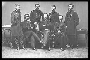 """Sherman and His Generals,"" a photograph by George N. Barnard. Standing from left to right are Oliver Howard, William Hazen, Jefferson C. Davis, and Joseph Mower. Seated from left to right are John Logan, W.T. Sherman, and Henry Slocum."