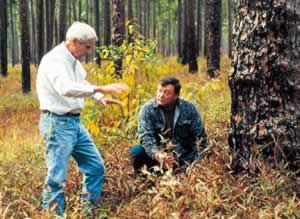 Neel and Jerry McCollum, president of Georgia Wildlife Federation,  in an old-growth forest. Photo by Richard T. Bryant. Email richard_t_bryant@mindspring.com
