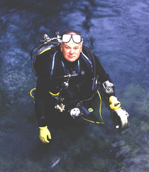 DeLoach emerges from a dive at Radium Springs in southwest Georgia. He is a leader on regional water issues based on his diving experience, work at Miller Brewing Company, and citizen volunteer efforts. Photo by Richard T. Bryant. Email richard_T_bryant@mindspring.com
