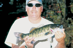 Kyle West proudly holds a prize shoal bass. Photo by Richard T. Bryant. Email richard_T_bryant@mindspring.com