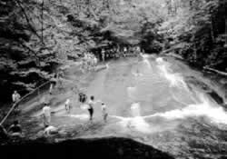 Many generations have enjoyed the innocent fun of shooting down Sliding Rock near Brevard.