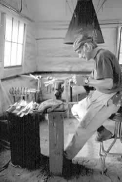 Mountain folk arts have a strong tradition in Western North Carolina and there are many places to witness the fine handicrafts and traditions of the area. Above, a craftsman at the John C. Campbell Folk School in Brasstown, North Carolina.